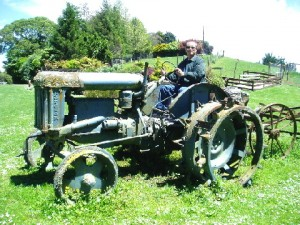 Writer on a broken-down farm tractor