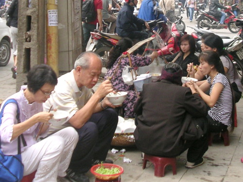 Writer and his wife having a roadside meal