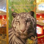 "A poster showing a white tiger at the ""Theatrical Safari"""