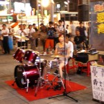 A young busker entertaining the public