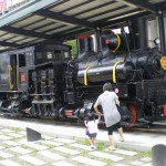 An old steam-engined train outside the Jiji Train Museum