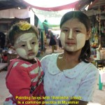 Painting faces with 'thanakha' cream