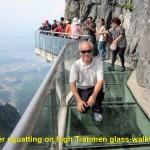 Writer squatting on Tianmen Glass-Walkway