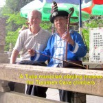 A Tujia musician playing musics for climbers