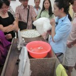 Sales-girl talking about silkworms